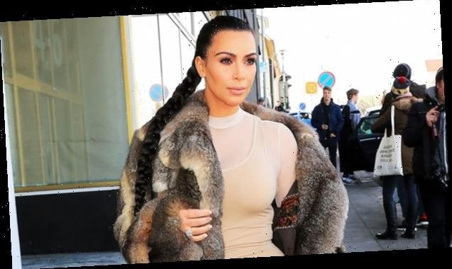 Kim Kardashian Wears Wedding Ring & Yeezys While Cuddling North & Their Dogs In Throwback Pic