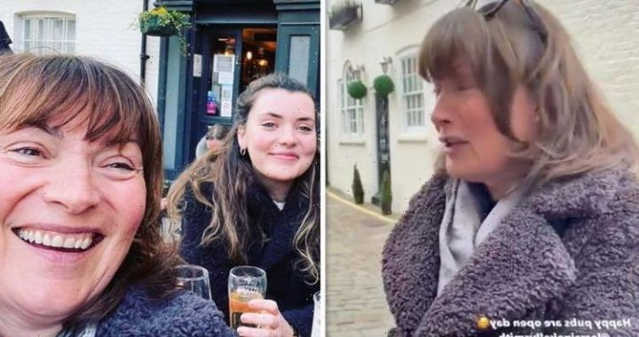 Lorraine Kelly grimaces as she knocks back shot on night out with lookalike daughter