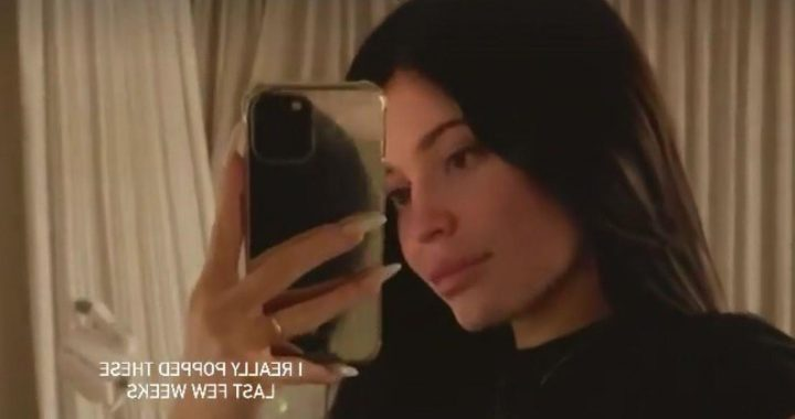 Kylie Jenner flaunts baby bump and says shes really popped in rare clip