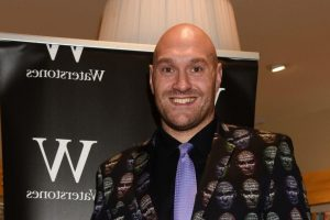 Tyson Fury wears a suit with his face plastered on as he supports wife Paris at book signing