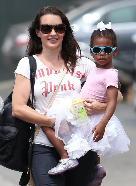 Celebrities with adopted child